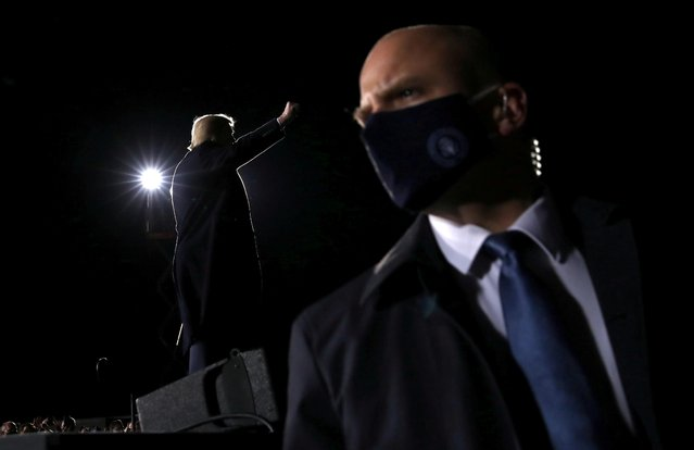 A member of security looks on as U.S. President Donald Trump addresses a campaign rally in Dalton, Georgia, U.S., on the eve of the run-off election to decide both of Georgia's Senate seats January 4, 2021. (Photo by Leah Millis/Reuters)