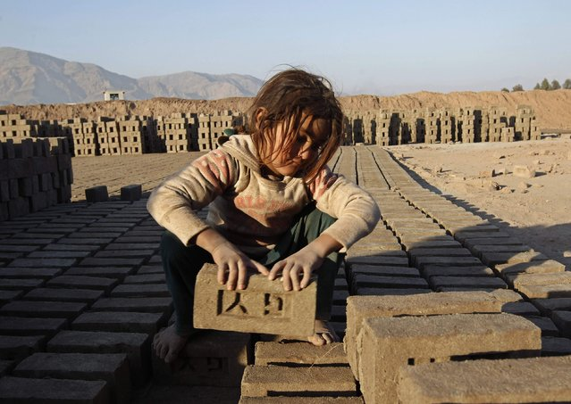 An Afghan girl works at a brick-making factory in Nangarhar province January 6, 2015. (Photo by Reuters/Parwiz)