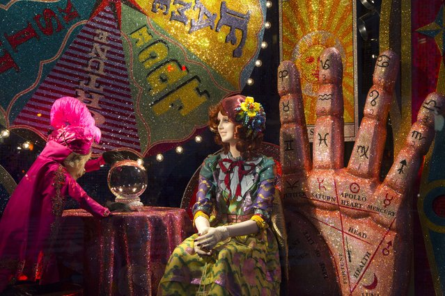 A fortune teller display appears in a holiday window at Bergdorf Goodman, Tuesday, November 24, 2015 in New York. Many New York stores participate in the seasonal ritual of window display pageantry. (Photo by Mark Lennihan/AP Photo)