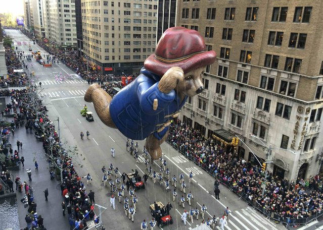 A float proceeds high above spectators along 6th Ave during the 89th Macy's Thanksgiving Day Parade in the Manhattan borough of New York November 26, 2015. (Photo by Carlo Allegri/Reuters)