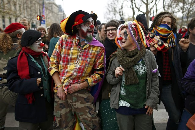 Environmentalists gather during a protest near the Place de la Republique after the cancellation of a planned climate march following shootings in the French capital, ahead of the World Climate Change Conference 2015 (COP21), in Paris, France, November 29, 2015. (Photo by Benoit Tessier/Reuters)