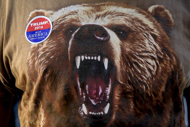 """An image of a bear is seen on the clothing of Republican U.S. presidential candidate Donald Trump supporter Ray """"Bear"""" McCook, as he makes his way into the Macon Coliseum before a Trump for President campaign rally in Macon, Georgia November 30, 2015. McCook says he is voting for Trump because, """"America needs to go in a different direction"""". (Photo by Christopher Aluka Berry/Reuters)"""