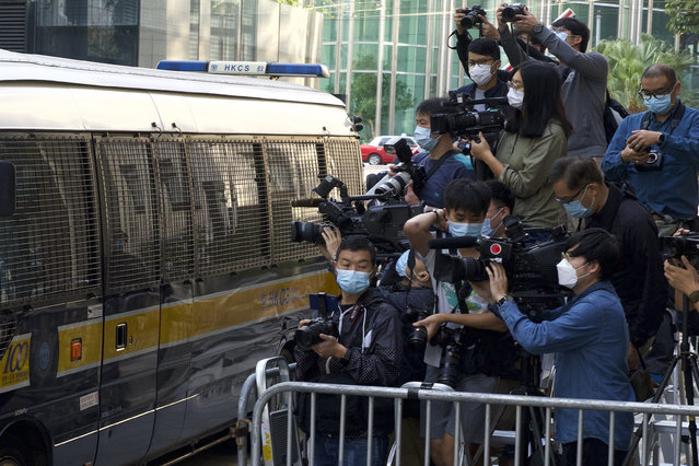 """Photographers cover democracy advocate Jimmy Lai arriving at Hong Kong's Court of Final Appeal where the government is arguing against allowing him bail in Hong Kong Monday, February 1, 2021. Lai is charged with """"collusion"""" under the new National Security Law that Beijing imposed on Hong Kong last year. (Photo by Vincent Yu/AP Photo)"""