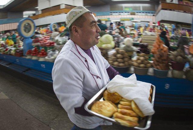 A vendor sells snacks at the Green Bazaar in Almaty January 23, 2015. (Photo by Shamil Zhumatov/Reuters)