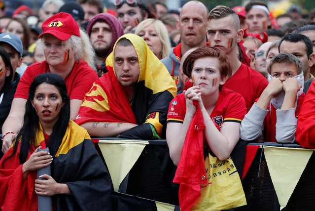 Belgium supporters react after France' s scored its first goal as they gather at a fan zone in Brussels on July 10, 2018 to watch the Russia 2018 World Cup semi- final football match between France and Belgium. (Photo by Yves Herman/Reuters)