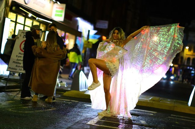 People party on a street as pubs shut for the night due to tier 3 restrictions in Soho, as the spread of the coronavirus disease (COVID-19) continues in London, Britain, December 15, 2020. (Photo by Aaron Chown/The Sun)