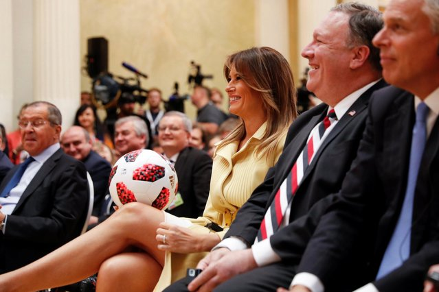 U.S. First Lady Melania Trump smiles as she holds a football thrown to her by U.S. President Donald Trump during his joint news conference with Russia's President Vladimir Putin after a meeting in Helsinki, Finland, July 16, 2018. (Photo by Kevin Lamarque/Reuters)