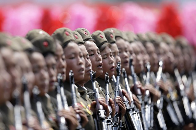 Female North Korean soldiers parade to mark the 60th anniversary of the signing of a truce in the 1950-1953 Korean War at Kim Il-sung Square, in Pyongyang. (Photo by Jason Lee/Reuters)