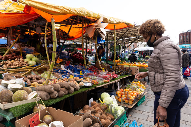 A woman in protective face mask is seen shopping by a stall at Lewisham street market as the second wave of Coronavirus hits London, England on October 6, 2020. (Photo by Dominika Zarzycka/NurPhoto via Getty Images)