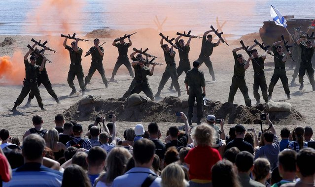 Marines demonstrate their skills as they take part in a military show during the celebration of Navy Day in St. Petersburg, Russia, on July 28, 2013. (Photo by Dmitry Lovetsky/Associated Press)