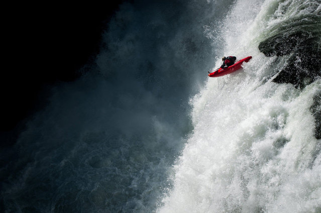 Photographer: David Carlier. Athlete: Gary Edgeworth. Location: Lower Mesa Falls, Idaho. (Photo by David Carlier/Red Bull Illume via The Atlantic)
