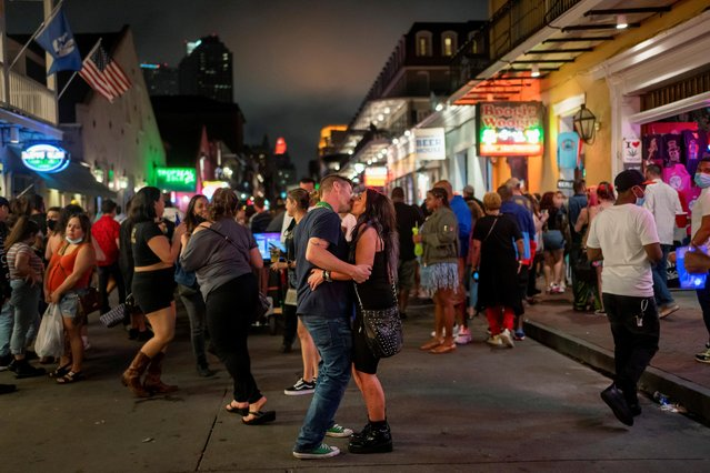 People wander around Bourbon Street as the coronavirus disease (COVID-19) restrictions are eased in New Orleans, Louisiana, U.S., March 13, 2021. (Photo by Kathleen Flynn/Reuters)