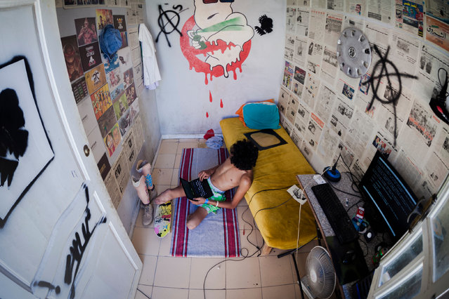 """Guesmi in his self-decorated bedroom. After his accident, he told writer Tebourski Hosn: """"I was doing nothing all the time and I couldn't bear it so I decided to join a football team but it didn't go well – in fact, I wasn't really welcomed – so I quit"""". (Photo by Yassine Alaoui Ismaili/The Guardian)"""