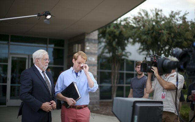 Chris Hurst (R), a journalist at the station and boyfriend of slain journalist Alison Parker, pauses for a moment as Jeff Marks (L), general manager for WDBJ7, looks on while they speak with NBC's Today Show outside of the offices for WDBJ7, where slain journalists Parker and Adam Ward worked in Roanoke, Virginia, United States August 27, 2015. (Photo by Chris Keane/Reuters)