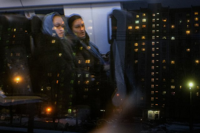This picture taken on March 15, 2021, shows two women traveling by train on the outskirts of Moscow. (Photo by Dimitar Dilkoff/AFP Photo)