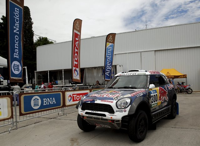 Nasser Al-Attiyah of Qatar drives his Mini as he leaves the technical verification area ahead of the Dakar Rally 2016 in Buenos Aires, Argentina, January 1, 2016. (Photo by Marcos Brindicci/Reuters)