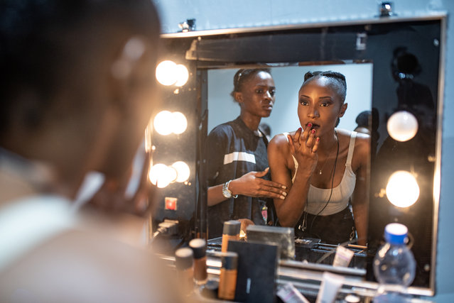 Model Cynthia Ikapa says modelling is about more than clothes, it is an expression of the love the tailors put into their work. (Photo by Olivia Acland/The Guardian)