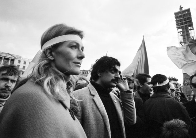 British actress Vanessa Redgrave and British author Tariq Ali arrive in Trafalgar Square, London, on March 17, 1968, to address the crowd in the anti-Vietnam war demonstration. Nelson's Column, top right, is undergoing major cleaning. (Photo by AP Photo)