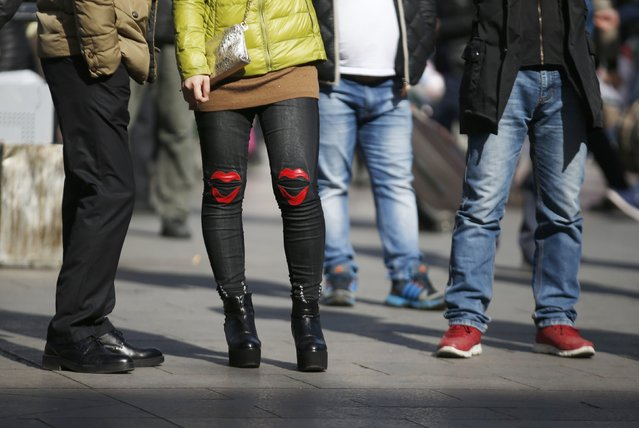 Lip-shaped patterns are seen on a pair of jeans at a railway station in Beijing February 16, 2015. (Photo by Kim Kyung-Hoon/Reuters)
