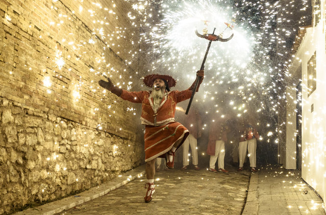 """Correfocs"" (fire runners) set of their fireworks among the crwod during Sitges' little ""Festa Major"", ""Santa Tecla"" festival in Sitges, Spain on September 15, 2018. (Photo by Matthias Oesterle/ZUMA Wire/Rex Features/Shutterstock)"
