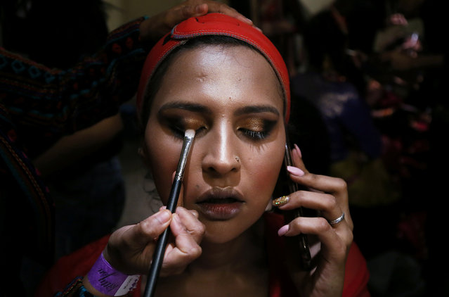 A contestant prepares backstage before the Miss Transqueen India 2018 transgender beauty pageant in Mumbai, India on October 7, 2018. (Photo by Francis Mascarenhas/Reuters)