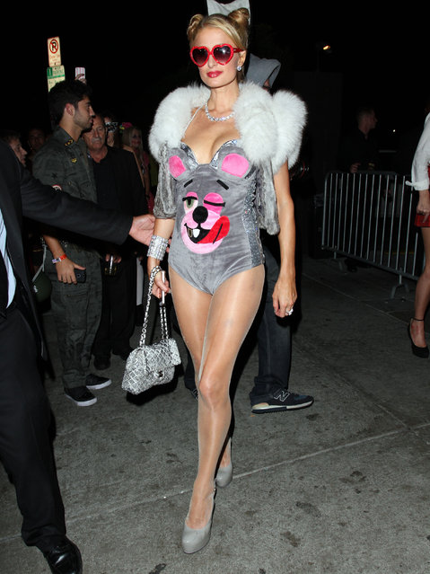 Paris Hilton proudly shows off her assets in her Halloween costume after leaving a party at the Roosevelt Hotel with her sister Nicky and boyfriend River in Hollywood, California on October 26, 2013. (Photo by FameFlynet)