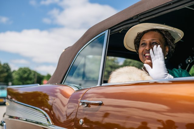 A woman dressed as Loula Tom Williams waves during commemorations of the 100th anniversary of the Tulsa Race Massacre on May 29, 2021 in Tulsa, Oklahoma. May 31st of this year marks the centennial of when a white mob started looting, burning and murdering in Tulsa's Greenwood neighborhood, then known as Black Wall Street, killing up to 300 people and displacing thousands more. Organizations and communities around Tulsa are preparing to honor and commemorate survivors and community residents. (Photo by Brandon Bell/Getty Images)