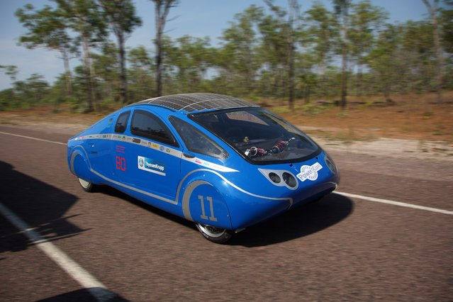 A undated handout image provided by the Bochum University of Applied Sciences (Hochschule Bochum) on 04 October 2013 shows the German team Bochum's Cruiser class solar car during a test drive in the Northern Territoty, Australia, 16 September 2013. The Dutch vehicle is competing in the World Solar Challenge, driving from Darwin to Adelaide starting on 06 October 2013. (Photo by Hochschule Bochum/EPA)