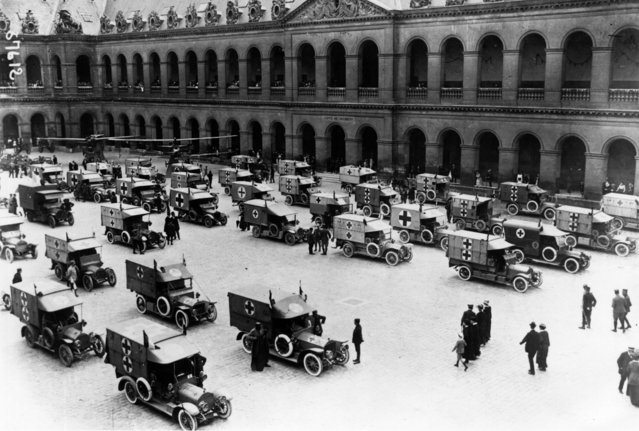 A group of AA Ambulances gather in a square in Paris, before leaving for the Front, 1st July 1915. (Photo by Topical Press Agency/Getty Images)