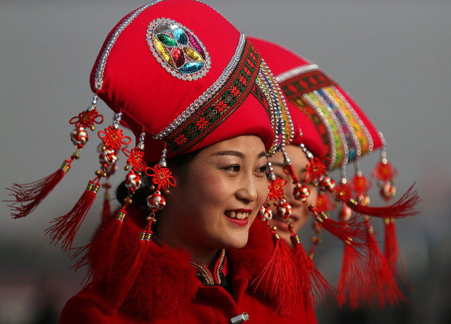 Chinese stewardesses wearing ethnic minority costumes arrive on Tiananmen Square prior to the opening session of the 12th National Peoples Congress (NPC) at the Great Hall of the People in Beijing, China, 05 March 2015. The NPC has over 3,000 delegates and is the world's largest parliament or legislative assembly though its function is largely as a formal seal of approval for the policies fixed by the leaders of the Chinese Communist Party. (Photo by How Hwee Young/EPA)