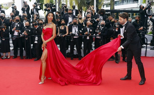 """Cuban model Maylin Aguirre arrives for the screening of the film """"France"""" at the 74th edition of the Cannes Film Festival in Cannes, southern France, on July 15, 2021. (Photo by Eric Gaillard/Reuters)"""