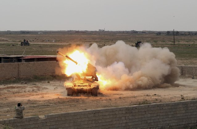 Iraqi security forces launch rockets against Islamic State extremist positions in Tikrit, 130 kilometers (80 miles) north of Baghdad, Iraq, Saturday, March 28, 2015. The Iraqi troops pressed their push in the city Saturday against IS militants holed up in the center of the city. (Photo by Khalid Mohammed/AP Photo)