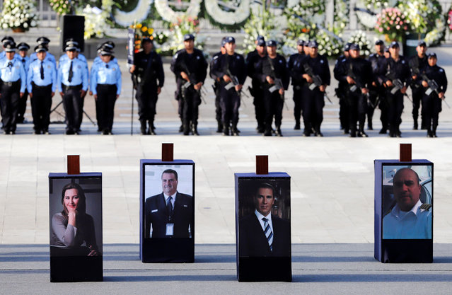 Urns with ashes of Martha Erika Alonso (L), a senior opposition figure and governor of the state of Puebla, her husband Rafael Moreno (C), a senator and former Puebla governor, and two crew members are displayed over their photographs during a homage in Puebla, Mexico December 25, 2018. (Photo by Imelda Medina/Reuters)