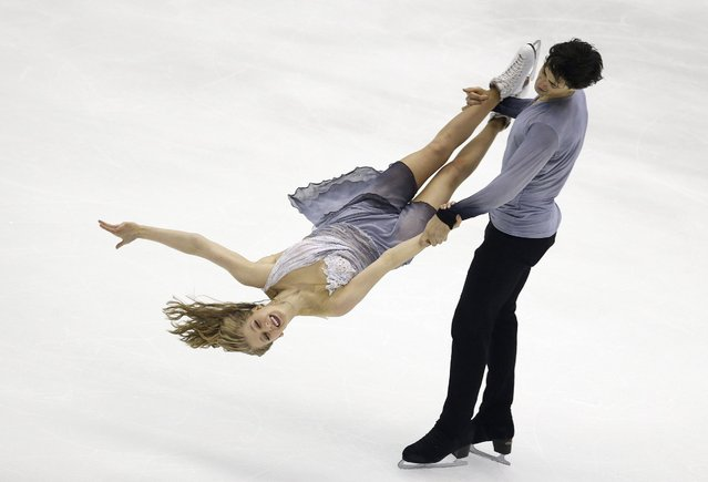 Kaitlyn Weaver and Andrew Poje from Canada perform in the Ice Dance Free Dance program at the Taiwan ISU Four Continents Figure Skating Championships in Taipei, Taiwan, Friday, February 19, 2016. Weaver and Poje finished in third place. (Photo by Wally Santana/AP Photo)