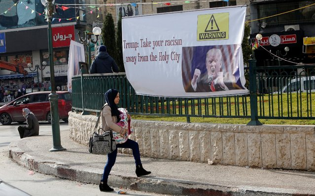 A Palestinian woman walks past a banner against a promise by U.S. President-elect Donald Trump to relocate the U.S. embassy to Jerusalem, in the West Bank city of Nablus January 19, 2017. (Photo by Abed Omar Qusini/Reuters)