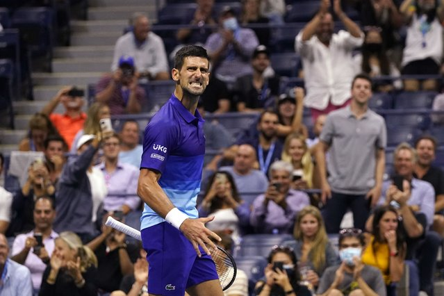 Novak Djokovic, of Serbia, reacts after scoring a point against Matteo Berrettini, of Italy, during the quarterfinals of the U.S. Open tennis tournament early Thursday, September 9, 2021, in New York. (Photo by Frank Franklin II/AP Photo)