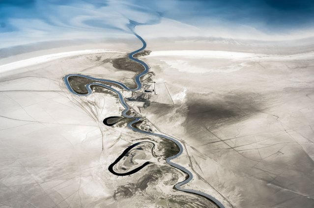 Zohreh River. Abstract Commended. Faux colour infrared image of the Zohreh River where it enters the Persian Gulf in southern Iran. The image was taken at 665nm, on an infrared-converted Sony Nex 5N. Red and blue channels were swapped in Photoshop. (Photo by Jon Bowles/Drone Photography Awards 2021)