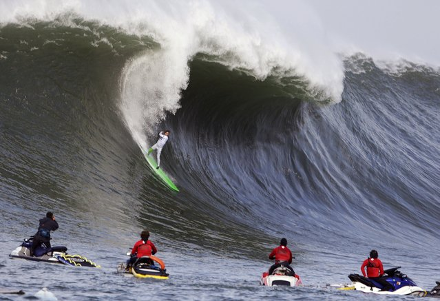 Nic Lamb rides a wave during the third heat of the first round of the Mavericks Invitational big wave surf contest Friday, January 24, 2014, in Half Moon Bay, Calif. (Photo by Eric Risberg/AP Photo)