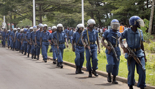 Burundian riot police patrol following clashes with opposition protesters in a street in the capital Bujumbura, Burundi Sunday, April 26, 2015. Hundreds of people in Burundi protested in the capital Sunday after the country's ruling party nominated President Pierre Nkurunziza to run for a third term. (Photo by Eloge Willy Kaneza/AP Photo)