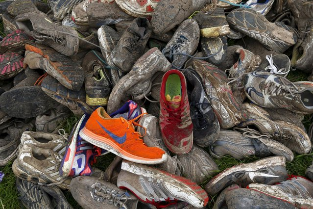 Discarded running shoes are seen at the Tough Mudder challenge near Henley-on-Thames in southern England May 2, 2015. (Photo by Eddie Keogh/Reuters)