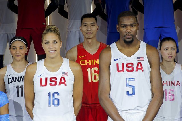 Athletes from different countries and sports pose wearing new jerseys and footwear made by Nike during an unveiling event in New York, March 17, 2016. (Photo by Eduardo Munoz/Reuters)