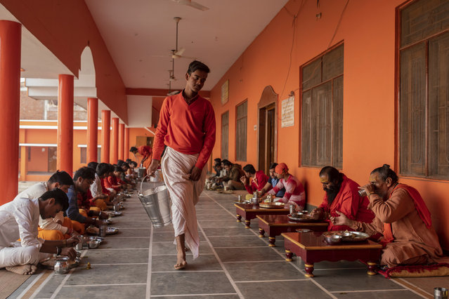 In this Wednesday, December 12, 2018 photo, Hindu students of the Baghambari Math Gaddi have lunch in Prayagraj, India. As with similar movements across the world, Hindu nationalism, once fringe, has now taken a central place in India's politics. (Photo by Bernat Armangue/AP Photo)