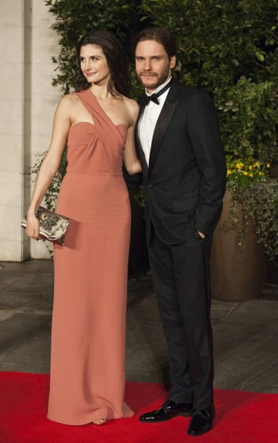 German actor Daniel Bruhl and Felicitas Rombold arrive on the red carpet for 2014 EE British Academy Film Awards Gala Dinner held at the Grosvenor House Hotel in Central London, Britain, 16 February 2014. (Photo by Will Oliver/EPA)
