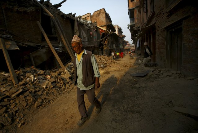 A man walks past collapsed houses after the April 25 earthquake at Bhaktapur May 7, 2015. (Photo by Navesh Chitrakar/Reuters)