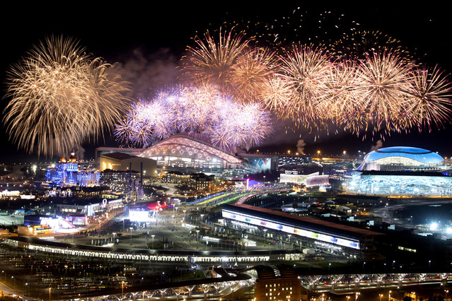 Fireworks explode over Olympic Park at the end of the closing ceremony of the 2014 Winter Olympics, Sunday, February 23, 2014, in Sochi, Russia. (Photo by Pavel Golovkin/AP Photo)