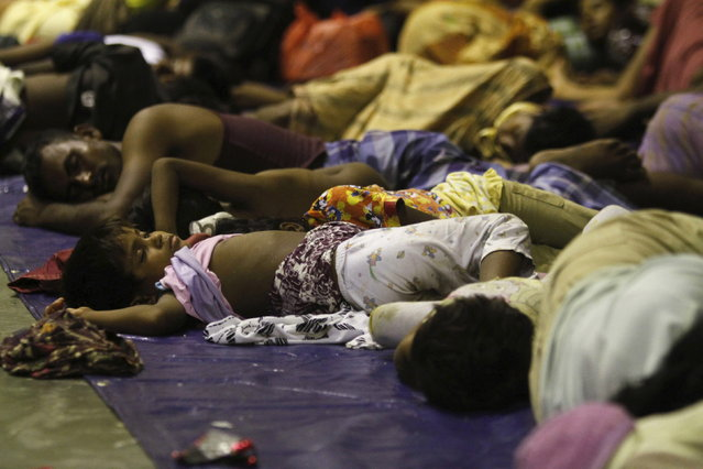 Migrants believed to be Rohingya rest inside a shelter after being rescued by fishermen at Lhoksukon in Indonesia's Aceh Province May 11, 2015. (Photo by Roni Bintang/Reuters)