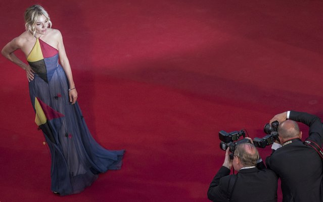 "Jury member actress Sienna Miller poses on the red carpet as they arrive for the screening of the film ""The Sea of Trees"" in competition at the 68th Cannes Film Festival in Cannes, southern France, May 16, 2015. (Photo by Vianney Le Caer/Reuters)"