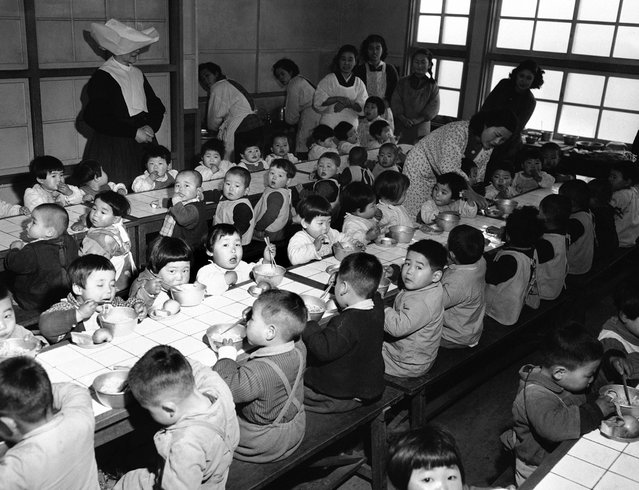 Dining room of an orphanage in Osaka, Japan, on February 19, 1951, where the 160 orphans were fed each day on food purchased by the Wolfhounds, the 27th Infantry Regiment of the U.S. Army. (Photo by Jim Pringle/AP Photo via The Atlantic)