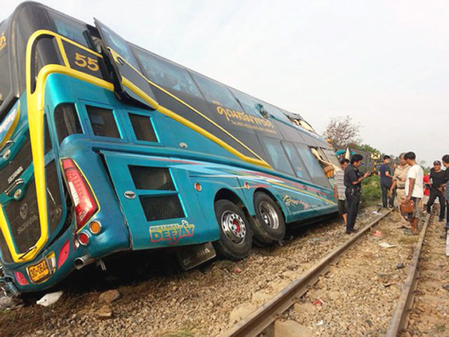 A wreckage bus after crashing with passenger train at accident site in Nakhon Chai Si district, Nakhon Pathom province, Thailand, 03 April 2016. At least three people were killed and nearly 30 others injured after a passenger train crashed into a tourist bus on a crossing railway, media reports. (Photo by EPA/Stringer)