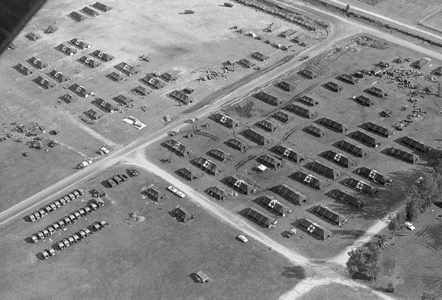 A group of U.S. Army hospital tents and ambulances, set up at the Opa Locka airport, formerly a marine air station in Miami, Florida in November of 1962. (Photo by Harold Valentine/AP Photo)